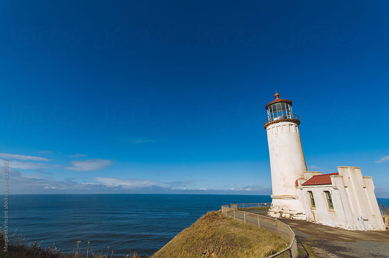 lighthouse on the pacific coast by Margaret Vincent for Stocksy United