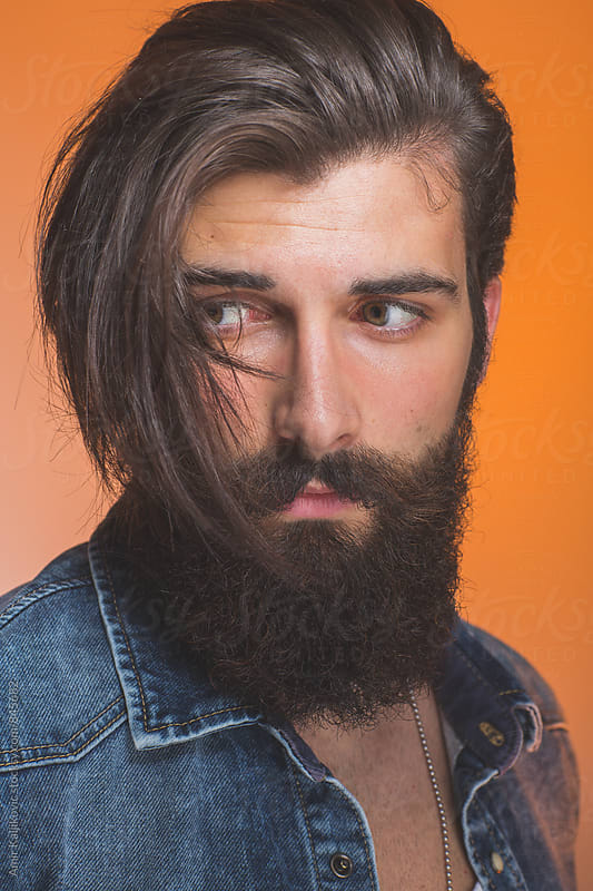 Attractive bearded man with a trendy hairstyle by Amir Kaljikovic for Stocksy United