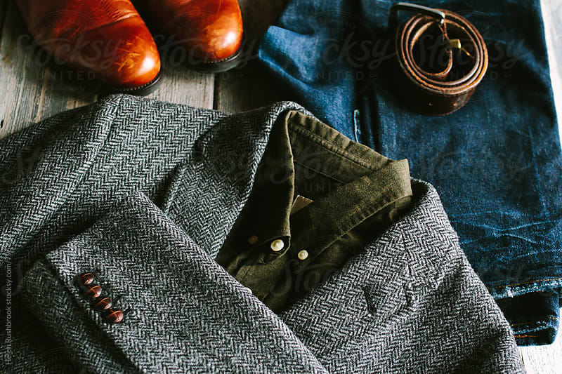 A modern gentleman's tweedy ensemble. by Helen Rushbrook for Stocksy United