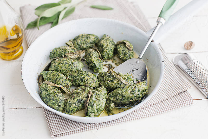 Food: Malfatti, Spinach Ricotta Dumplings with Sage Butter in a  by Ina Peters for Stocksy United
