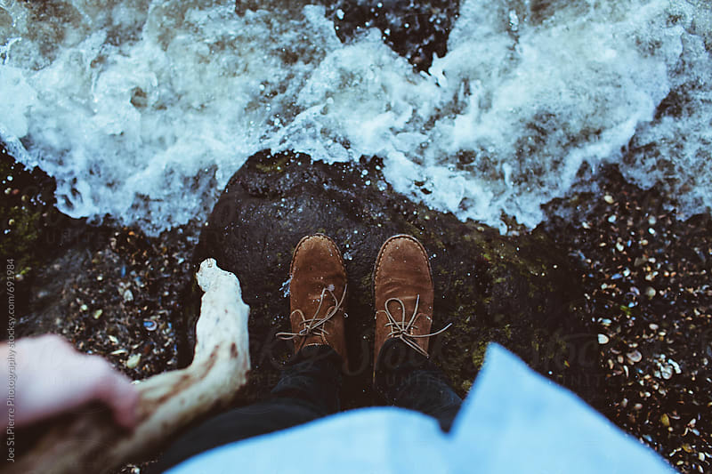Feet in the ocean by Joe St.Pierre Photography for Stocksy United