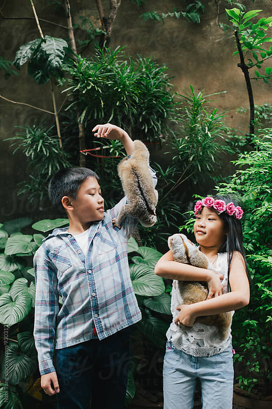 Children and wild animal in the open zoo by Nabi Tang for Stocksy United