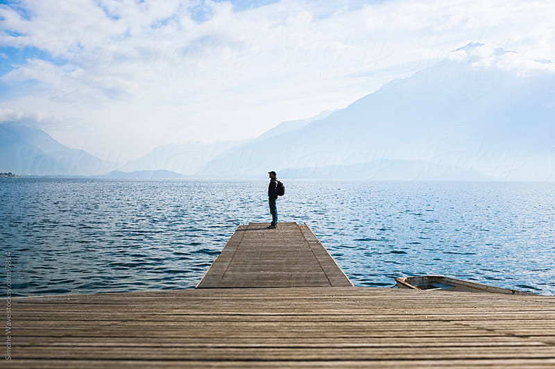 Man Standing on a Jetty by Simone Becchetti for Stocksy United