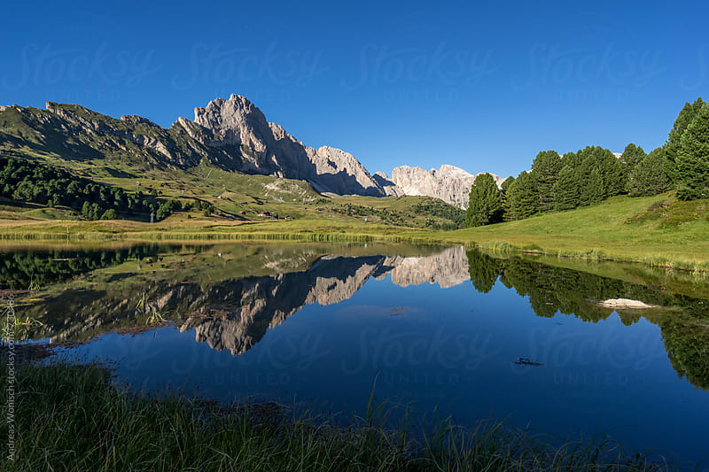 Mountain reflection in the Dolomites by Andreas Wonisch for Stocksy United