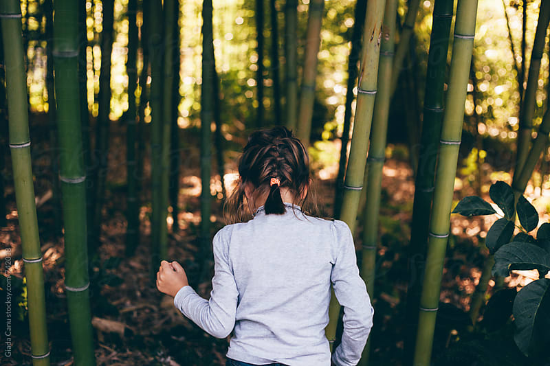 Girl exploring a bamboo forest by Giada Canu for Stocksy United