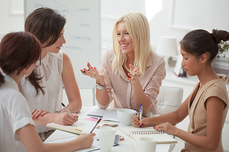 Smiling Businesswomen Working Together by Lumina for Stocksy United