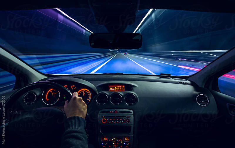 Car cockpit at night by Mark Korecz for Stocksy United