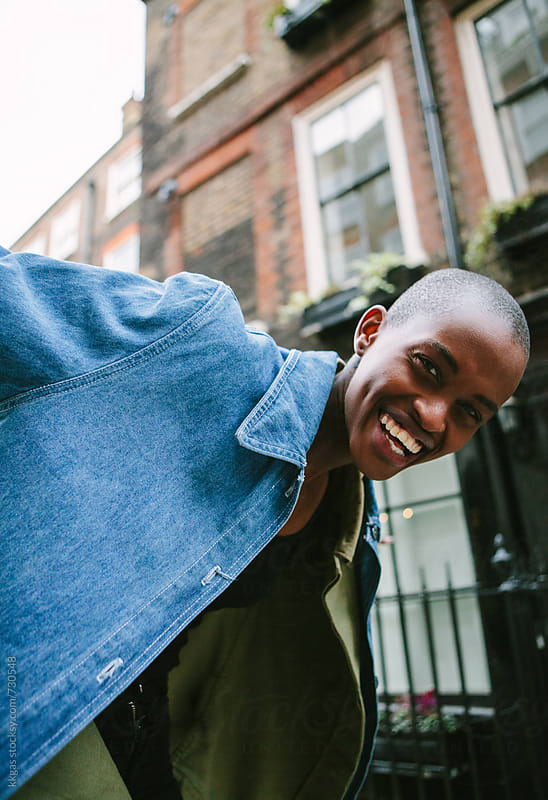 Beautiful androgynous black woman laughing by kkgas for Stocksy United