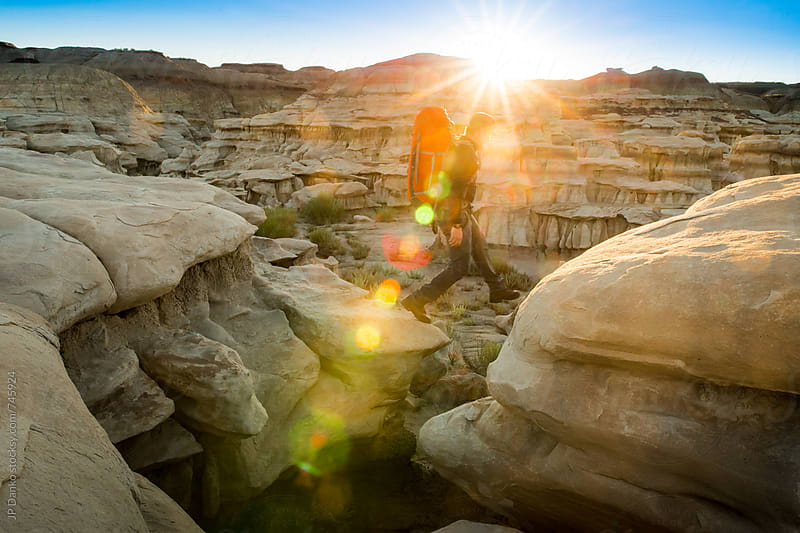 Man Backpacking in Bisti Badlands Wilderness Area New Mexico at Sunrise by JP Danko for Stocksy United