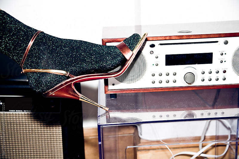 Sparkle sock in high heel with radio by Sari Wynne Ruff for Stocksy United