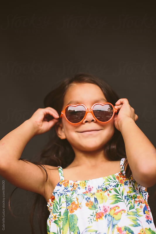 Young Girl in Sunglasses Being Silly by Gabrielle Lutze for Stocksy United