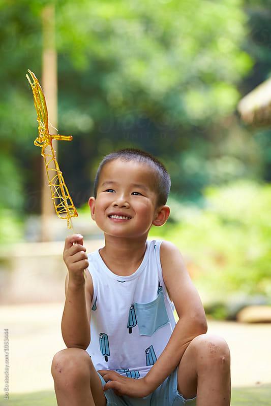 happy little boy outdoor by Bo Bo for Stocksy United