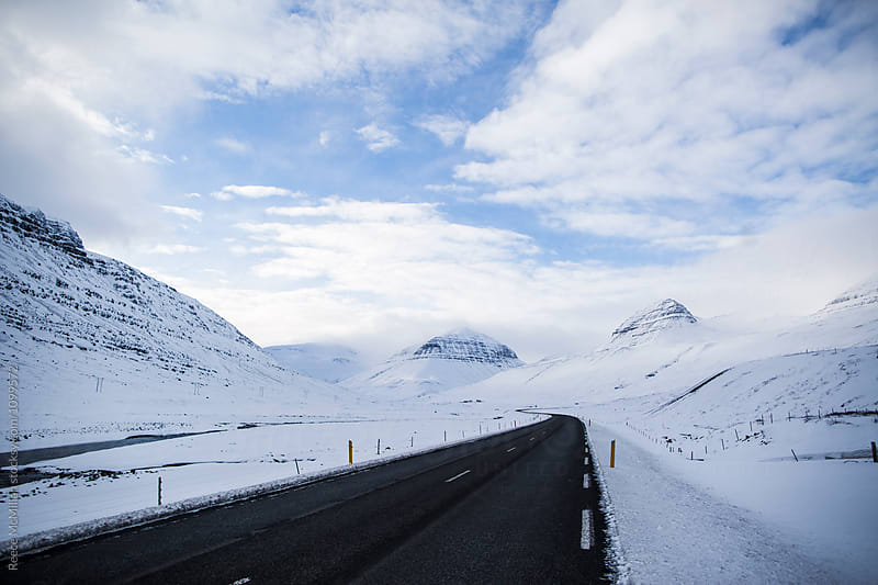 The open road, on an Icelandic road trip by Reece McMillan for Stocksy United