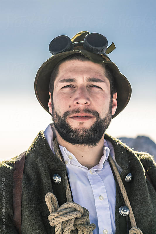 portrait of a bearded man in old, nostalgic mountaineering outfit by Leander Nardin for Stocksy United