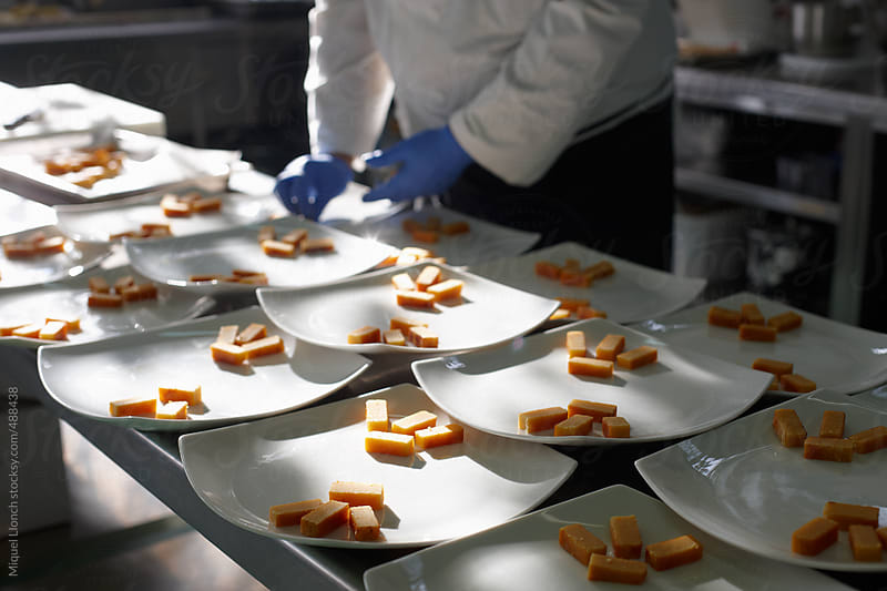 Preparation of spanish christmas dessert plates for a feast by Miquel Llonch for Stocksy United