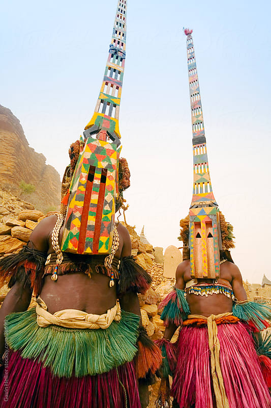 Africa, West Africa, Mali, Dogon Country, Bandiagara escarpment, Masked Ceremonial Dogon Dancers near Sangha by Gavin Hellier for Stocksy United