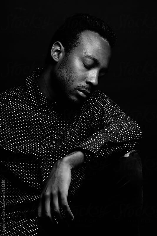 Single black man by Leandro Crespi for Stocksy United