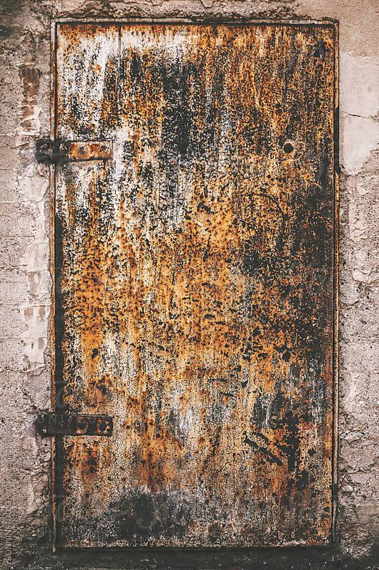 Old rusty metal door.  by BONNINSTUDIO for Stocksy United