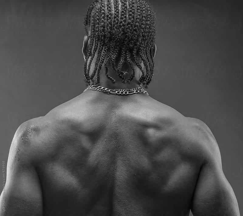 muscular black man with strong back  by Igor Madjinca for Stocksy United