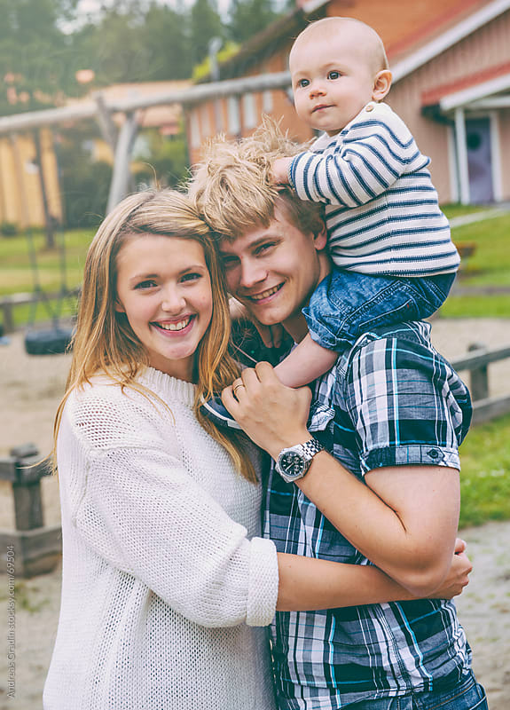 young happy family hugging by Andreas Gradin for Stocksy United
