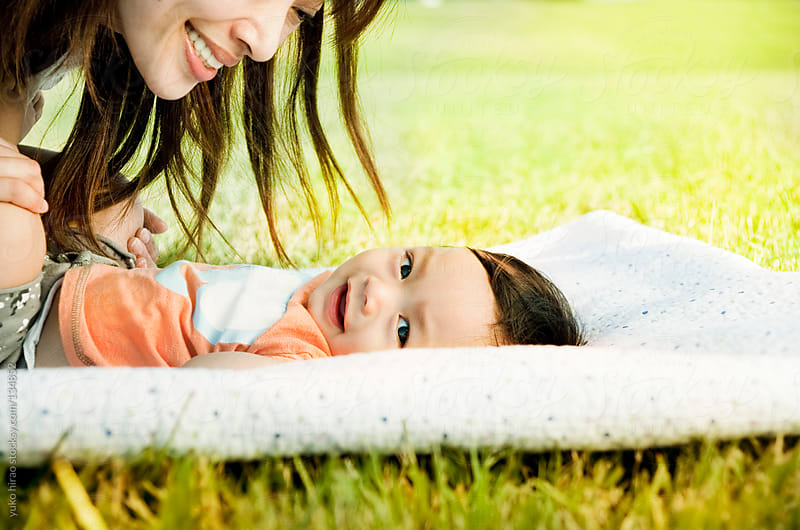 Smiling Asian baby on grass by yuko hirao for Stocksy United
