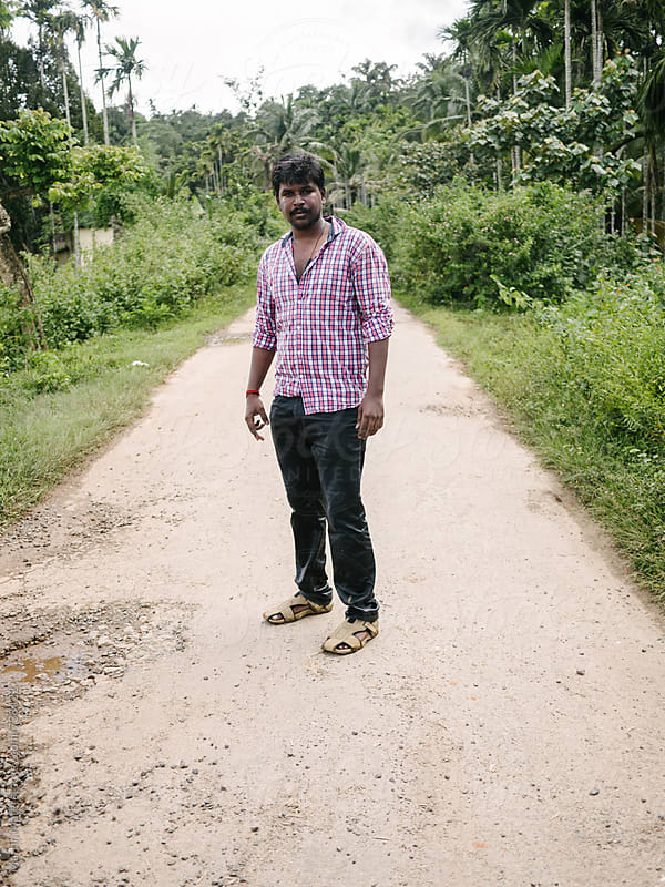 Indian man standing on the road by Martin Matej for Stocksy United