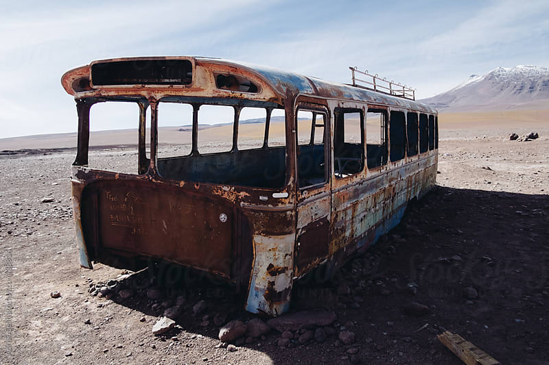 Rusty bus in the Bolivian desert by Adrian Seah for Stocksy United