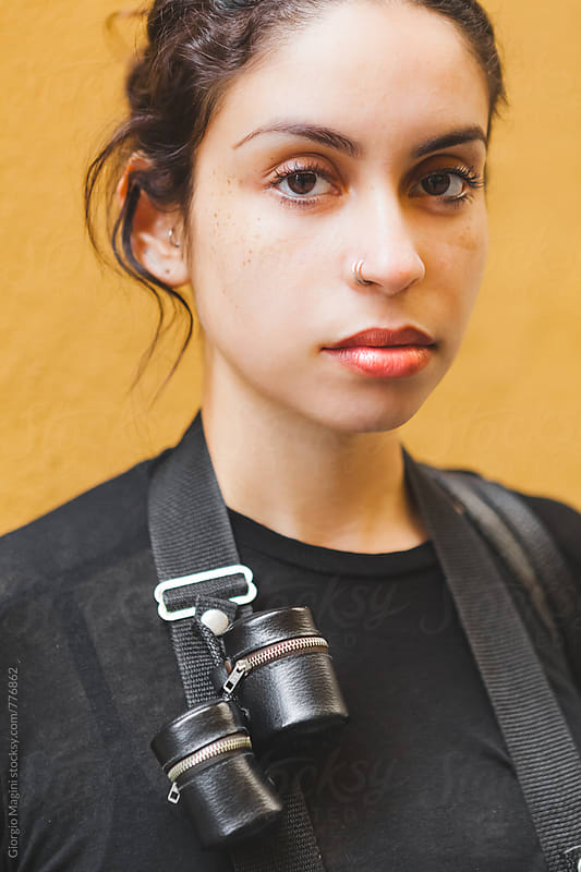 Portrait of a Young Pretty Photographer with Film Holders on the Camera Strap by Giorgio Magini for Stocksy United