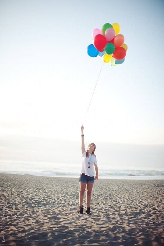 Beach Balloon Woman by Kevin Russ for Stocksy United
