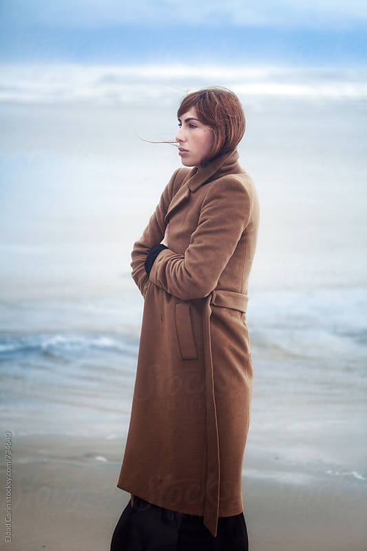Mellow Woman at Wintery Beach by Eldad Carin for Stocksy United