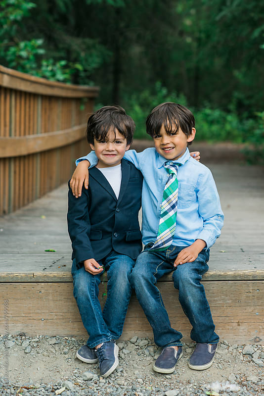 two young brothers smiling  by Tara Romasanta for Stocksy United