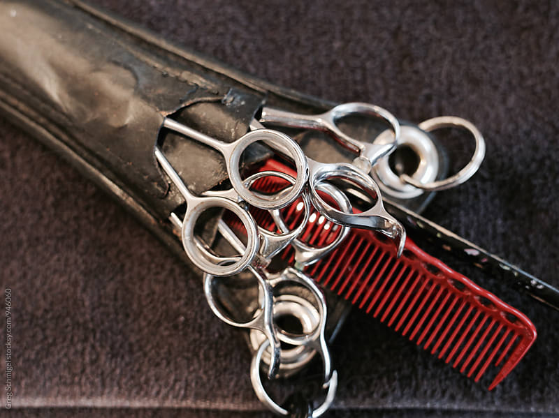 barber scissors and combs in a leather holster by Greg Schmigel for Stocksy United