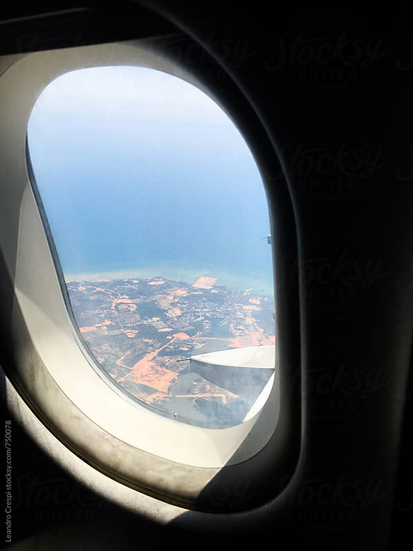 An airplane window by Leandro Crespi for Stocksy United