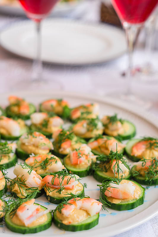 gluten free appetizer with prawn and cucumber by Gillian Vann for Stocksy United