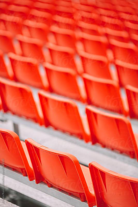 Empty red seats  by Alexey Kuzma for Stocksy United