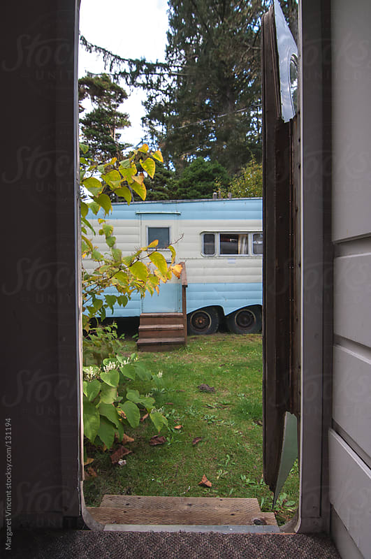 view through a trailer door by Margaret Vincent for Stocksy United