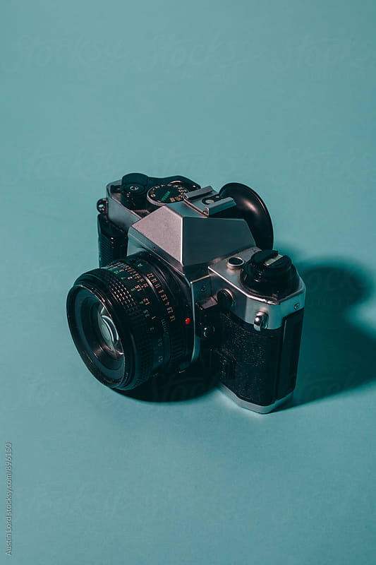 Vintage Camera on Blue Background by Austin Lord for Stocksy United
