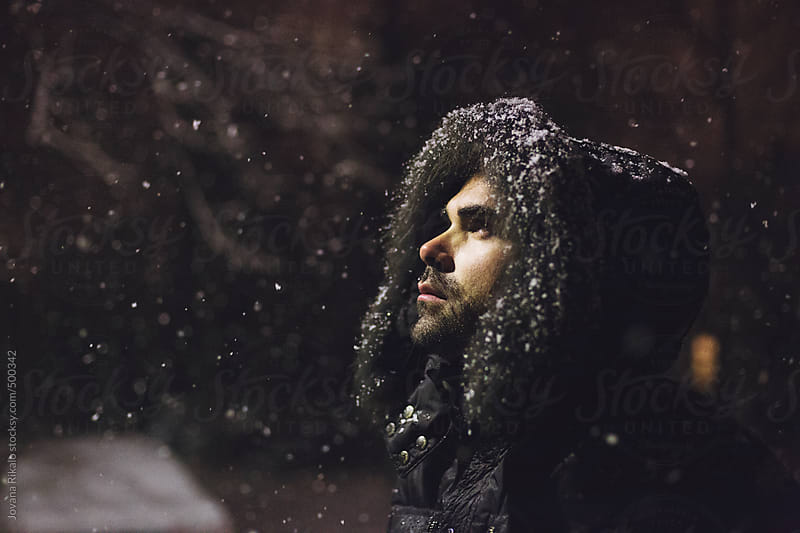 Man In Hooded Coat Outdoors In Snowfall  by Jovana Rikalo for Stocksy United