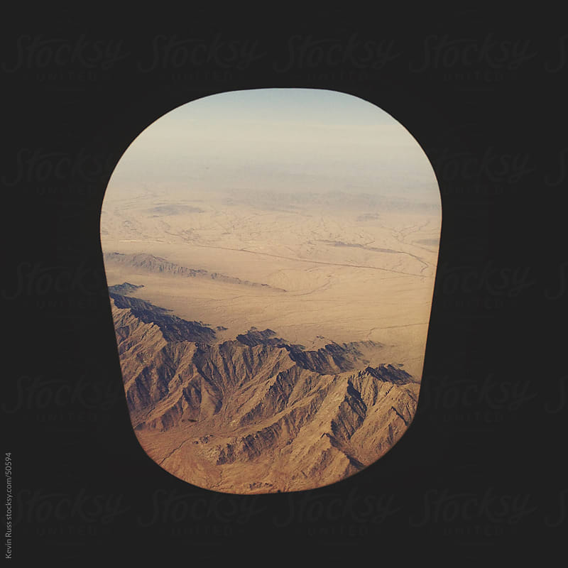 Arizona Mountains Airplane Window View by Kevin Russ for Stocksy United