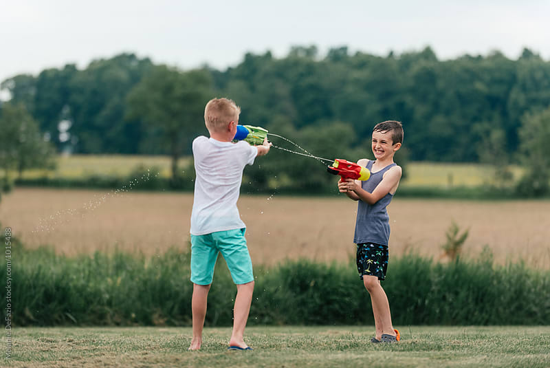 water guns by Melanie DeFazio for Stocksy United