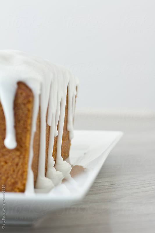 Lemon Loaf, icing (frosting) dripping/running down by Kirsty Begg for Stocksy United