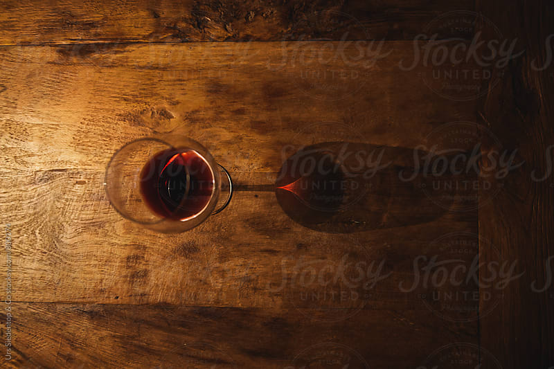 Red wine glass with prism reflection by Urs Siedentop & Co for Stocksy United