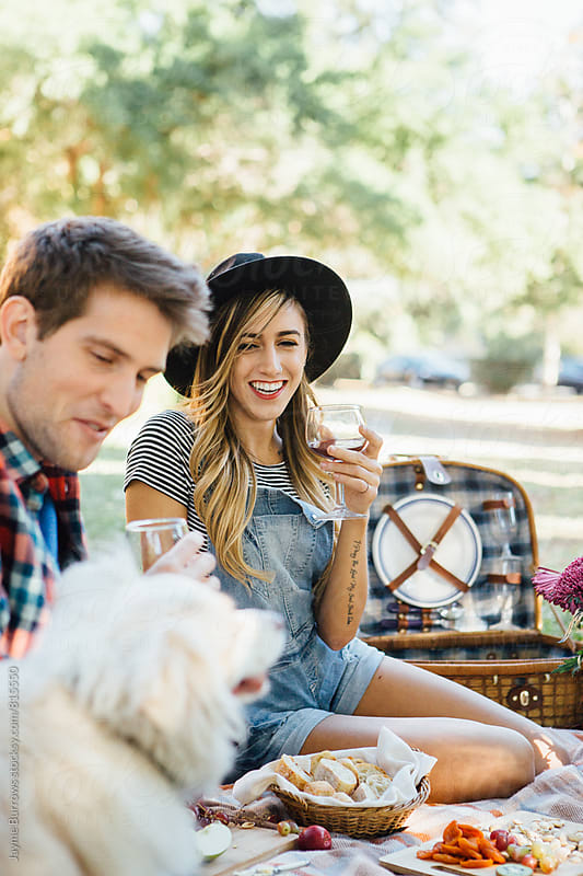 Couple with Dog on a Picnic by Jayme Burrows for Stocksy United