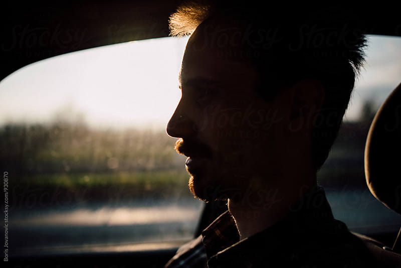 Portrait of bearded man in the car by Boris Jovanovic for Stocksy United