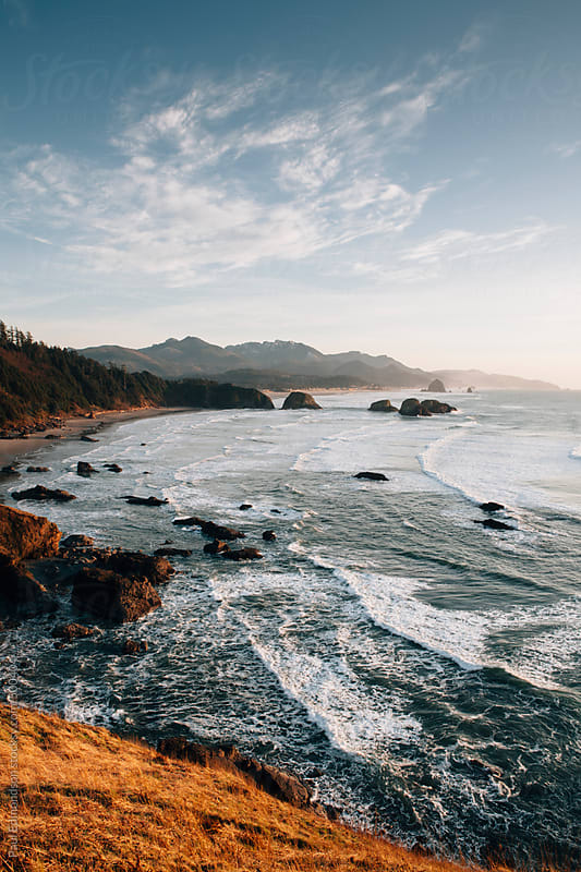 View of Cannon Beach and Oregon coastline at dusk, from Ecola State Park by Paul Edmondson for Stocksy United