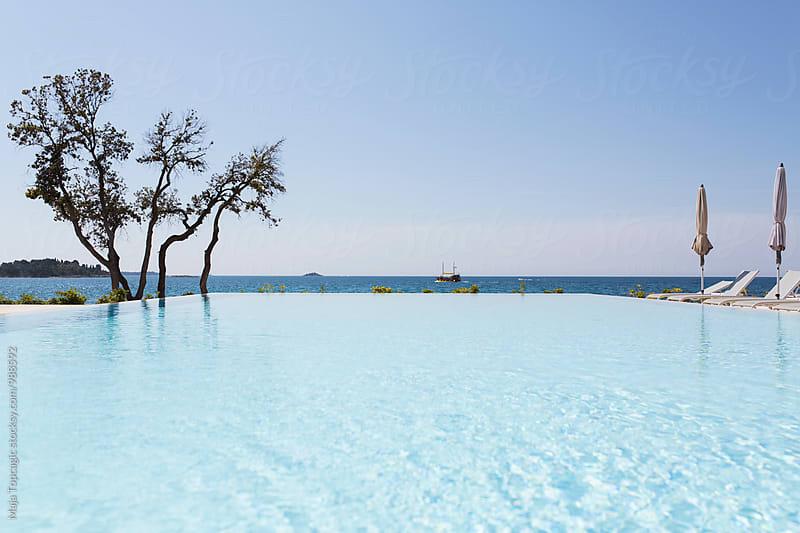Pool near seashore by Maja Topcagic for Stocksy United