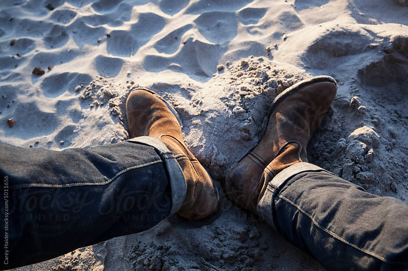 Cowboy Boots In The Sand by Carey Haider for Stocksy United
