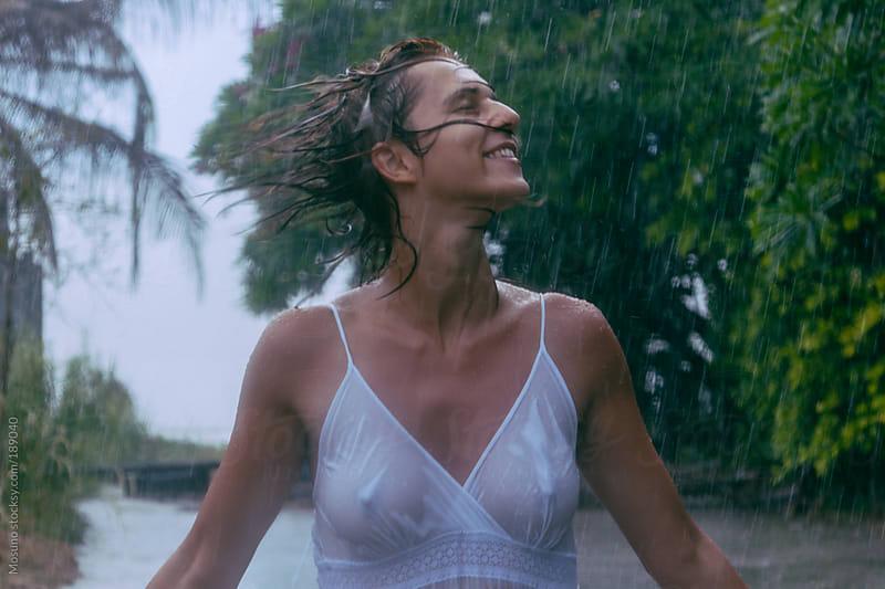 Woman Enjoying the Summer Rain by Mosuno for Stocksy United