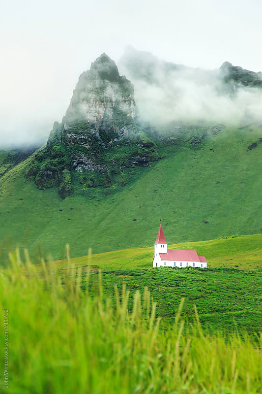 A church on the hill above Vik. Iceland. by John White for Stocksy United