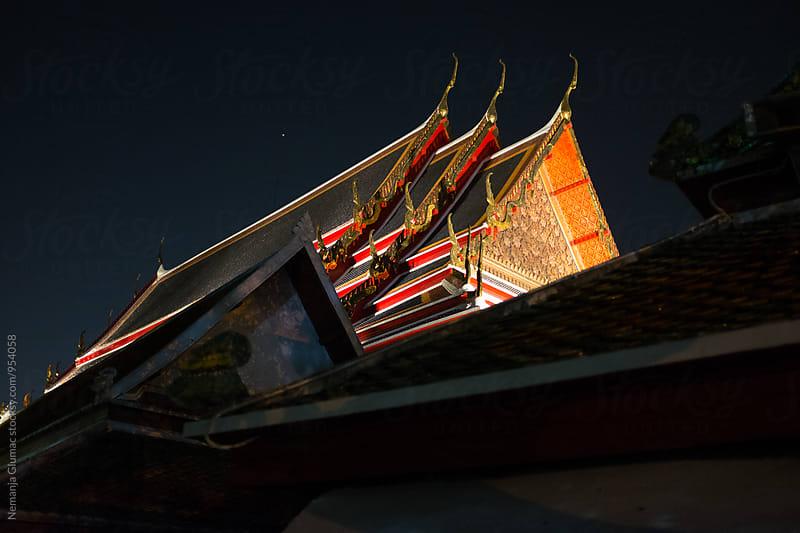 Thai Buddhist Temple Roof at Night by Nemanja Glumac for Stocksy United